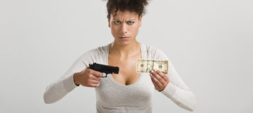 Shooting money Stock Images