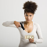 Shooting money Royalty Free Stock Image