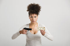 Shooting money Royalty Free Stock Photography