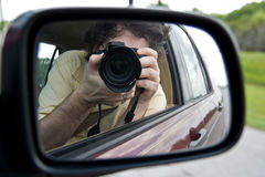 Shooting Myself. Shallow DOF picture of myself shooting a pic of myself in the sideview mirror of a moving vehicle Royalty Free Stock Photography