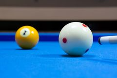 Shooting a billiard ball royalty free stock photos