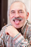 Shooting out tongue Royalty Free Stock Photography