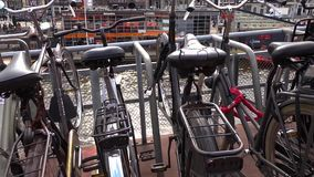 Shooting of parking with lot of different bicycles on a canal near Train Station in Amsterdam stock video