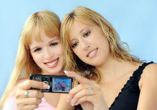 Shooting with phone. Girls making photo with mobile phone Royalty Free Stock Photo