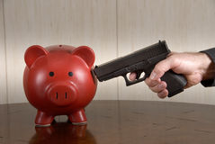 Shooting piggybank Royalty Free Stock Image