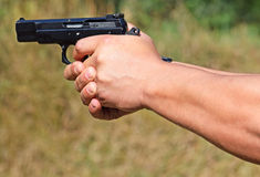 Shooting with a pistol. In hand Stock Photos