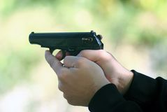 Shooting with a pistol. Shooting with the Makarov pistol with two hands royalty free stock photography