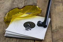 Shooting and pneumatic weapon. Shield and hits with lead bullets Stock Photography