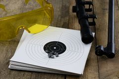 Shooting and pneumatic weapon. Shield and hits with lead bullets Royalty Free Stock Photo