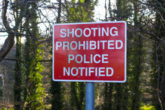 A Shooting Prohibited sign on a path used by anglers. And country walkers that leads to the small reservoir at Portavoe in Groomsport Co Down Ireland. This Stock Photos