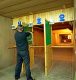 Shooting range. A man is shooting paper targets at a shooting range Stock Photos