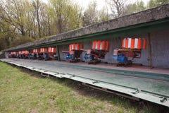 Shooting range equipment for flying targets - orange pigeons stock photos