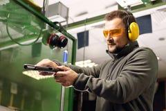 Shooting range. Shooting a gun at a shooting range stock photo