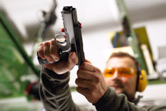 Shooting range. Shooting a gun at a shooting range Royalty Free Stock Images