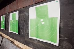 Shooting range gun. Paper target in white and green color for hit.  royalty free stock image