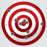 Shooting Range Gun Target with Bullet Holes. Red and white shooting range target shot full of bullet holes Stock Photos