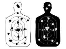 Shooting range gun target with bullet holes. Royalty Free Stock Photography