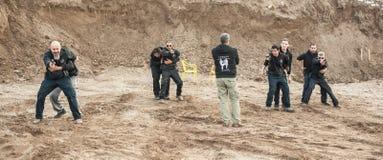 Shooting range. Instructor Avi Nardia teaches large group of students royalty free stock photo