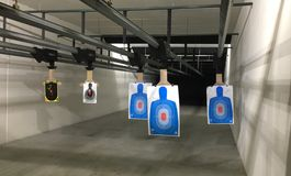 Shooting Range. Looking down range at targets in an indoor shooting range Stock Image