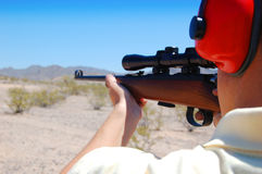 Shooting a Rifle. Shooting a .22 in the desert of Arizona Royalty Free Stock Photo