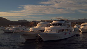 Shooting from the ship on harbor with its pleasure boats. Sharm el Sheikh, Egypt - January 8, 2017: Shooting from the ship on harbor with its pleasure boats stock video footage