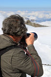 Shooting snow, ice and clouds of the Jungfraujoch royalty free stock photo