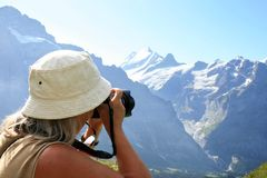 Shooting snow and ice in the Swiss mountains royalty free stock photo