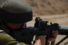 Shooting soldier. An israeli soldier shooting the Tavor gun Royalty Free Stock Image