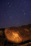 Shooting Star. Petroglyph of Shooting Star with Star Trails Royalty Free Stock Photography