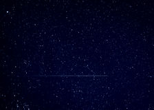 Shooting star meteor in night sky Royalty Free Stock Image