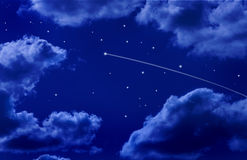 Shooting Star Night Sky. A night sky with stars, clouds and a shooting star Stock Photos