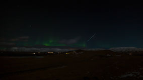 Shooting Star and Northen Lights over Iceland Royalty Free Stock Images