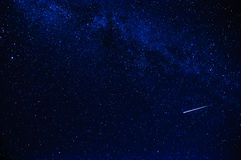 Shooting star in the sky. Shooting star on a dark blue starry sky Stock Photography