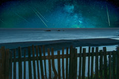 Shooting Stars. Falling over a tranquil ocean panorama royalty free stock photo