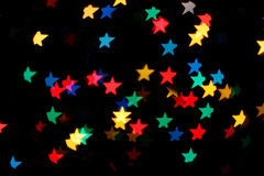 Shooting Stars glowing lights. Background with falling glowing multicolored stars Stock Photo