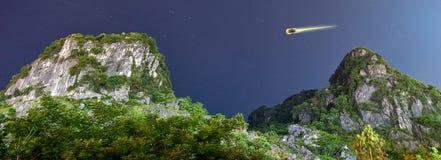 Shooting stars with mountains and stars at night in the National Park of Phong Nha Ke Bang, Vietnam. Panorama cut. Mountain and stars in the National Park of Royalty Free Stock Photo