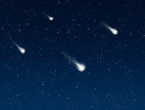 Shooting stars in night sky Royalty Free Stock Images