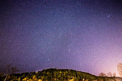 Shooting stars on a purple sky stock photo