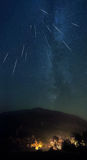Shooting stars. Starry sky and shooting stars over the mountain royalty free stock photo
