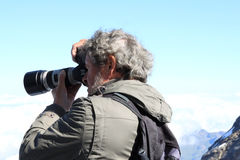 Shooting the sunny mountains at the Jungfraujoch stock images