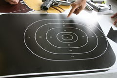 Shooting target. Finger pointing to a black shooting target with several rings and a bulls eye Royalty Free Stock Photo