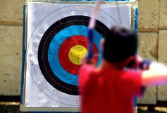 Shooting on a target during archery competition Royalty Free Stock Image