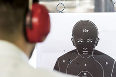 Shooting Target Black Human Silhouette with Holes Stock Photo