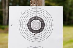 Shooting target with bullet holes. Shooting practice target with bullet holes royalty free stock image