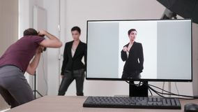 Shooting tethering in professional photo studio. The images are displayed on the screen of the computer stock video footage