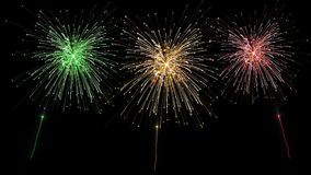Shooting three fireworks Stock Photography