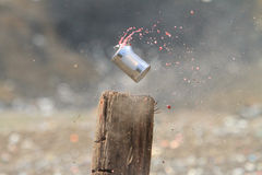 Shooting tin cans. Shooting full tin cans with high powered rifles royalty free stock photos