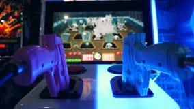 Shooting Toy Guns at Shooter Game Arcade Machine in Shopping Center. 4K. Bangkok, Thailand. stock video footage