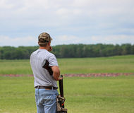 Shooting Trap. A young trap shooter waiting for his turn to shoot and standing in safety position Stock Photography