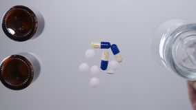 Shooting under the glass table with pills and drugs used in a medical cure